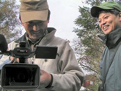 Producer and camerman in garden